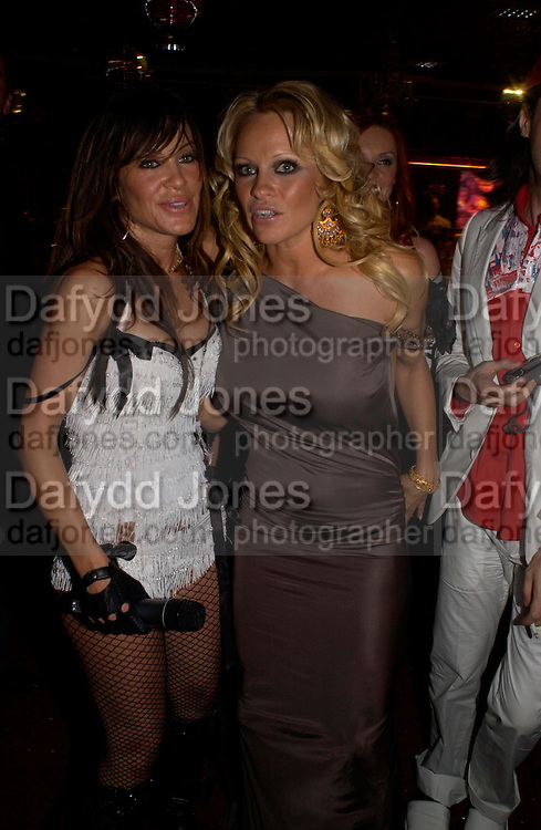 Pamela Anderson and member of the Pussy Cat Dolls. Selfridges Las Vegas dinner hosted by  hon Galen , Hillary Weston and Allanah Weston. Selfridges Oxford St. 20 April 2005. ONE TIME USE ONLY - DO NOT ARCHIVE  © Copyright Photograph by Dafydd Jones 66 Stockwell Park Rd. London SW9 0DA Tel 020 7733 0108 www.dafjones.com
