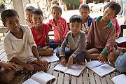 Children of all ages enjoying an English class run by ICS volunteers Luna Boran, Tania Tuzizila, Dan Hensman  & Sokuntheary Nhel  n the village at a host home, in the village of in Banteay Char, near Battambang, Cambodia.