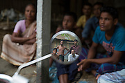 Members of Ponchoki Bhajini village located inside the enclave of Dhoholakhagrabari have meeting at their village about leaving for India. Being Hindu's 20 out of the 22 households, decided to become Indian citizen's and will move to India for ever later this year.<br /> <br /> On July 31st 2015 the enclaves that formed one of the world's most complicated borders were officially absorbed in to the countries that surrounded them in a land-mark land swap between India and Bangladesh. The people that lived in them will finally receive citizenship.<br /> <br /> Enclaves are small pockets of sovereign land completely surrounded by another sovereign nation. Approximately 160 enclaves, known as chitmahals, exist on either side of the India-Bangladesh border. For 68 years the 50,000 plus inhabitants of these enclaves have lived a difficult existence, stranded from their home nation and ignored by the country that surrounds them. <br /> <br /> In theory even leaving their enclaves is illegally crossing an international border and for decades it has been very difficult for them to receive even the most basic of rights whether education or health. Even the police have no jurisdiction in the enclaves leaving them essentially lawless.
