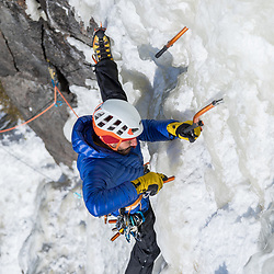 Jeff Mercier placing a screw on the route Indiana Thivierge, WI6. The third repeat in 25 years, Les Palisades Charlevoix in Quebec, Canada