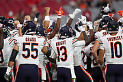 The Chicago Bears join in a group and raise their arms as they get fired up before the 2017 NFL week 2 preseason football game against the Arizona Cardinals, Saturday, Aug. 19, 2017 in Glendale, Ariz. The Bears won the game 24-23. (©Paul Anthony Spinelli)