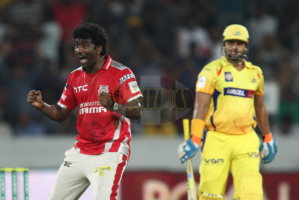 Parvinder Awana of the Kings XI Punjab celebrates getting Suresh Raina of the Chennai Super Kings wicket during the second semi final match of the Oppo Champions League Twenty20 between the Kings XI Punjab and the Chennai Superkings held at the Rajiv Gandhi Cricket Stadium, Hyderabad, India on the 2nd October 2014<br /> <br /> Photo by:  Shaun Roy / Sportzpics/ CLT20<br /> <br /> <br /> Image use is subject to the terms and conditions as laid out by the BCCI/ CLT20.  The terms and conditions can be downloaded here:<br /> <br /> http://sportzpics.photoshelter.com/gallery/CLT20-Image-Terms-and-Conditions-2014/G0000IfNJn535VPU/C0000QhhKadWcjYs