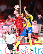 Crawley Town striker Matt Harrold wins a high ball against Accrington Stanley defender Joe Wright during the Sky Bet League 2 match between Crawley Town and Accrington Stanley at the Checkatrade.com Stadium, Crawley, England on 26 September 2015. Photo by Bennett Dean.