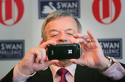 © under license to London News Pictures. 10/02/11 DJ Tony Blackburn takes pictures of the photographers at 2011 Oldie of the Year Awards at Simpsons On The Strand. Photo credit should read: Olivia Harris/ London News Pictures
