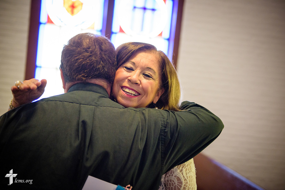 Church member Gloria Palacios welcomes the Rev. Dr. Antonio Lopez, new national missionary pastor at El Calvario Lutheran Church, before his installation service on Sunday, July 31, 2016, at the parish in Brownsville, Texas. LCMS Communications/Erik M. Lunsford