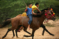 Wayuu Indian boys ride horses during a race that is part of the annual Wayuu Cultural Festival in Uribia, Colombia June 10, 2007. (Photo/Scott Dalton)