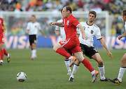 Wayne ROONEY and Thomas MUELLER during the 2010 World Cup Soccer match between England and Germany in a group 16 match played at the Freestate Stadium in Bloemfontein South Africa on 27 June 2010.
