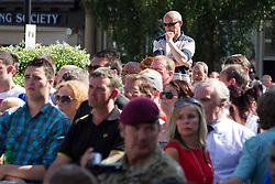 © Licensed to London News Pictures . 11/07/2013 . Bury , UK . The crowd watches . Drummers from the 2nd Battalion Royal Regiment of Fusiliers ( 2RRF ) drum the funeral cortege of Fusilier Lee Rigby up Bolton Street and in to Bury Parish Church in Bury town centre today (Thursday 11th July 2013) , watched by 100s of people . Fusilier Rigby's coffin will remain in Bury Parish Church overnight , with an honour guard of soldiers from the Regiment . His funeral is tomorrow (12th July) . Rigby was brutally murdered in Woolwich , London on . Photo credit : Joel Goodman/LNP
