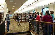 Trinity Renchin (second on left), student ambassador, leads a tour of prospective students and their parents during an open house in the Luise V. Hanson Library at Waldorf College in Forest City, Iowa on Saturday, May 14, 2011.
