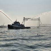 USS Keokuk (YTB-771), a US Navy Tugboat stationed at the Portsmouth Naval Shipyard. escorts tall ship Gazela near teh Memorial Bridge in Portsmouth Harbor, Portsmouth, NH