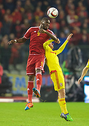 BRUSSELS, BELGIUM - Sunday, November 16, 2014: Belgium's Christian Benteke and Wales' Joe Allen during the UEFA Euro 2016 Qualifying Group B game at the King Baudouin [Heysel] Stadium. (Pic by David Rawcliffe/Propaganda)