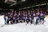 KELOWNA, CANADA - NOVEMBER 3:  The Kelowna Rockets' pose for a photo on the ice after the win against the Brandon Wheat Kings on Pink the Rink cancer fundraising night on November 3, 2018 at Prospera Place in Kelowna, British Columbia, Canada.  (Photo by Marissa Baecker/Shoot the Breeze)