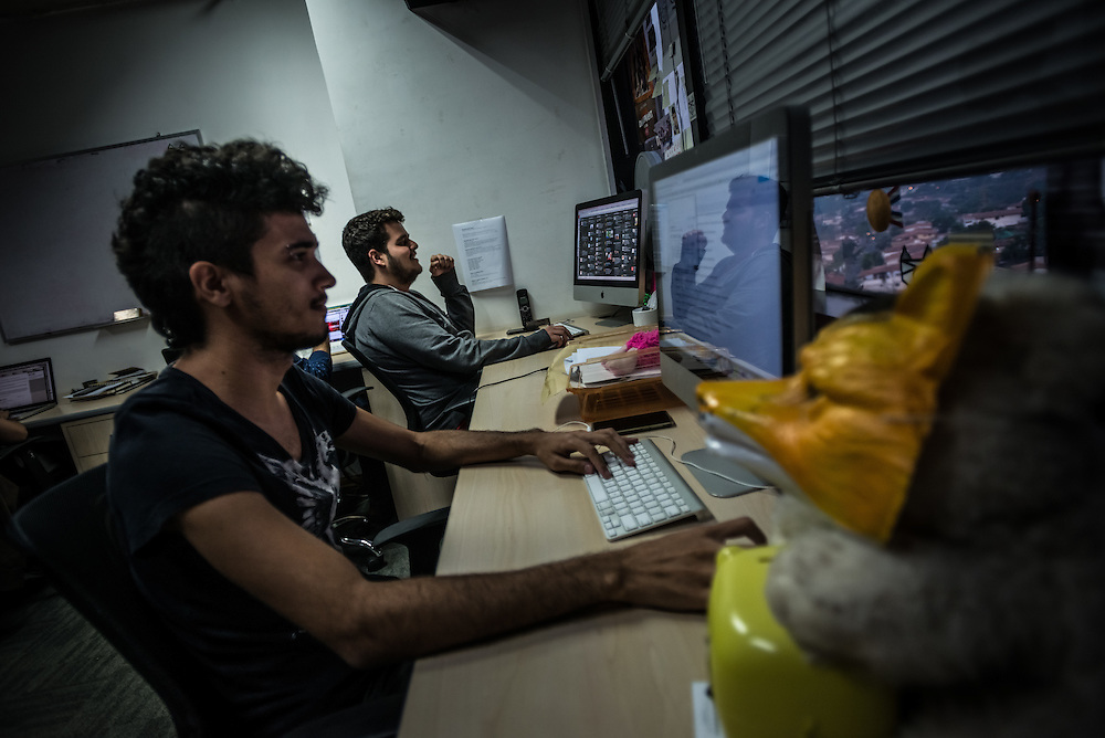 CARACAS, VENEZUELA - MAY 6, 2015:  Members of the creative team behind http://elmostacho.com work on creating content. ElMostacho.com is one of Venezuela's leading humor websites that regularly pokes fun of the challenges of day to day life here.   PHOTO: Meridith Kohut for Buzzfeed News