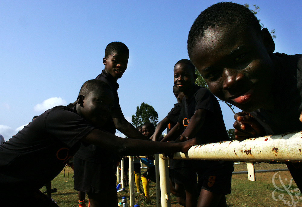 Teenage Ivorian football players take a break during their intensive morning training session at the ASEC football academy February 16, 2006 in Abidjan, Ivory Coast. ASEC academy has an established history of producing top notch footballers who go on to play in the top European football leagues.