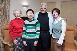 Group of older people with their carer in a care home,