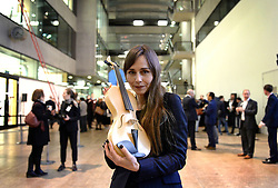 EDITORIAL USE ONLY Actress and Ex Central Saint Martins student Tara Fitzgerald holds a violin, which uses the vibrating qualities of spiders silk designed by overall winner Luca Alessandrini from Italy, at this year's International Student Innovation Awards at Central Saint Martins, London.
