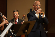 John Schlabach, Professor of Trumpet, performs with an ensemble of professors and alumni, in Glidden Hall during the Faculty and Alumni Centennial Chamber Music Recital on Friday, April 21, 2017. © Ohio University / Photo by Kaitlin Owens
