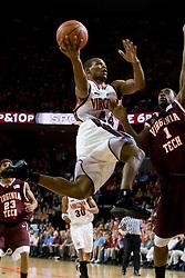 Virginia guard Sean Singletary (44) shoots over Virginia Tech guard/forward Terrell Bell (1).  The Virginia Cavaliers men's basketball team faced the Virginia Tech Hokies at the John Paul Jones Arena in Charlottesville, VA on January 16, 2008.