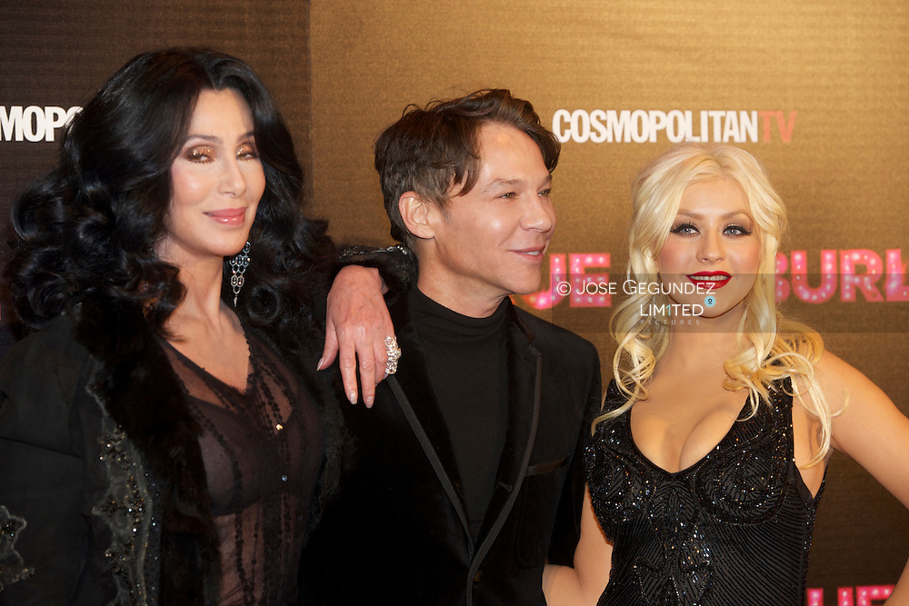 Cher, director Steven Antin and Christina Aguilera attend 'Burlesque' premiere at Callao cinema on December 9, 2010 in Madrid, Spain.