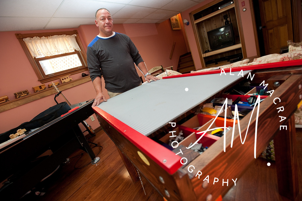 "Alan Korb stands behind one of his ""Tuff Table"" Lego play tables.  (Alan MacRae/for the Citizen)"
