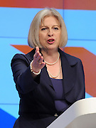 © Licensed to London News Pictures. 04/10/2011. MANCHESTER. UK. The Rt Hon Theresa May MP, Secretary of State for the Home Department and Minister for Women and Equalities, addresses The Conservative Party Conference at Manchester Central today, October 4, 2011. Photo credit:  Stephen Simpson/LNP