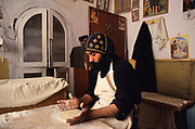 St Antony coptic monastery, in the night the monks prepare the bread. The monastey, nestled amount the mountains near the Red sea, is the oldest and biggest of the Coptics monasteries, founded in 4th century from disciples of St Antony. Here, in this desert, is born the Christian experience of the monks and monasteries.