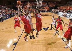 Virginia forward/center Ryan Pettinella (34) battles Maryland forward James Gist (15) and forward Bambale Osby (50) for a rebound.  The Virginia Cavaliers defeated the Maryland Terrapins 91-76 at the University of Virginia's John Paul Jones Arena  in Charlottesville, VA on March 9, 2008.