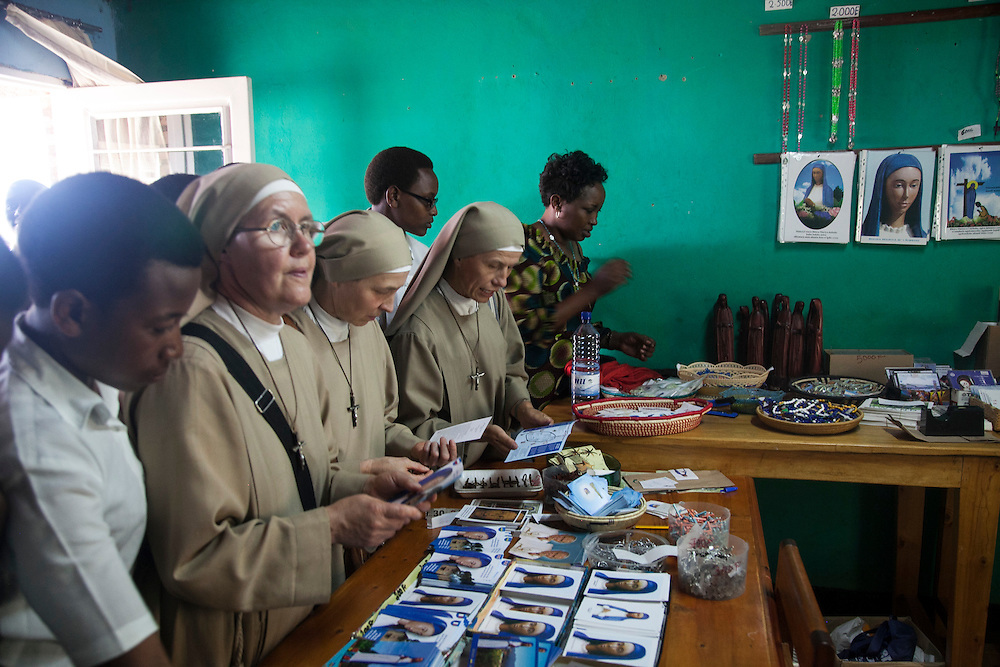 People browse items for sale at the The Shrine of Our Lady of Sorrows gift shop in Kibeho, Rwanda. This is the only sanctioned Marian sanctuary in Africa. Kibeho's overseers and the Rwandan government hope this place will become a top tourism site. Three young Rwandan women had visions of Mary, the first vision coming to Alphonsine Mumureke, then 16, on Nov. 28, 1981.<br /> <br /> Photographed on Sunday, October 26, 2014.<br /> <br /> Photo by Laura Elizabeth Pohl