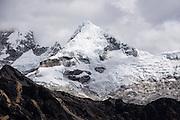 A glacier-covered peak rises above Mayobamba Valley, on day 6 of 10 days trekking in Huascaran National Park (UNESCO World Heritage Site), Cordillera Blanca, Andes Mountains, Peru, South America.