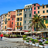 Colorful Houses along Palazzata in Portovenere, Italy <br /> Portovenere, Italy, is one of several charming maritime villages in Cinque Terre.  Called Portus Veneris during the first century B.C., it was named after Venus, the Roman goddess of love.  Enjoy your stroll along Palazzata where these pastel houses hug the shores of a peninsula.  Then take an excursion boat past the three, nearby islands that are filled with caves.  They inspired the scandalous romantic Lord Byron to write his poetry which is why the area is nicknamed the Gulf of Poets.