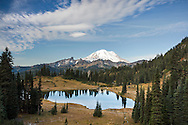 A cold October morning at Tipsoo Lake in Mount Rainier National Park, Washington State, USA. Yakima Peak is to the right, the Cowlitz Chimneys, Barrier Peak and Governors Ridge in center.  Photographed from the Tipsoo Lake Viewpoint along SR 410.