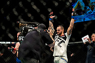 Santiago Ponzinibbio celebrates knocking out Gunner Nelson in the first round of their welterweight bout during the UFC Fight Night at the SSE Hyrdo, Glasgow.