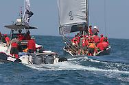 France's Areva Challenge sails away from team tender before start of America's Cup fleet race; Valencia, Spain.