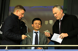 West Bromwich Albion owner Guochuan Lai looks amused as Premier League Chairman Peter Scudamore tries to find his seat - Mandatory by-line: Paul Roberts/JMP - 18/11/2017 - FOOTBALL - The Hawthorns - West Bromwich, England - West Bromwich Albion v Chelsea - Premier League