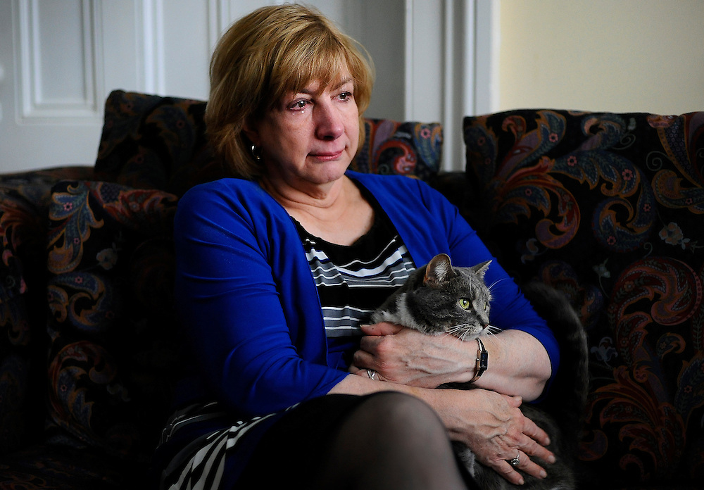 In this Tuesday, Feb. 5, 2013 photo, Teresa Rousseau holds her late daughter Lauren Rousseau's cat Laila during an interview with the Associated Press at her home in Danbury, Conn. Lauren Rousseau, 30, a teacher, was one of 26 people killed in the Dec. 14, 2012 massacre at Sandy Hook Elementary School in Newtown, Conn.  Lauren Rousseau will be one of six educators from the school honored posthumously with the 2012 Presidential Citizens Medal, presented at a White House ceremony on Feb. 15. (AP Photo/Jessica Hill)