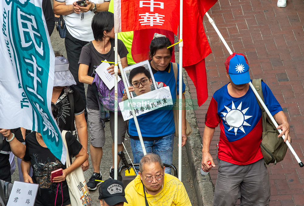 October 1, 2018 - Hong Kong, Hong Kong SAR, China - A pro Taiwan protester holds a photo of Hong Kong National Party leader Andy Chan. The NPHK was recently banned for its call for self-determination.National Day March in Hong Kong. On the 69th anniversary of the founding of the Peoples Republic of China, people take to the streets of Hong Kong Island to march, protest and have their views heard. Despite the recent banning of the Hong Kong National Party, Pro-Independence supporters were amongst the crowd. Joshua Wong stood firm under the Demosisto Party banner as calls go out for them to be banned next. (Credit Image: © Jayne Russell/ZUMA Wire)
