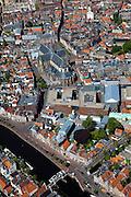 Nederland, Noord-Holland, Haarlem, 12-05-2009; overzicht van de stad met in het midden aan de Grote Markt het stadhuis en Grote Kerk of St. Bavokerk. Direkt onder de St. Bavo, het nieuwe complex de Appelaar (voorheen drukkerij Enschede, nu onder andere Gerechtsgebouw, concertzaal, hotel. Hier weer onder, aan het water van het Binnen Spaarne, het Teylersmuseum.  Overview from the air of the village of Haarlem, Great Church (center) the blue building (bottom middle) at the river Binnen Spaarne is the oldest museum of The Netherlands, The Teylers Museum..Swart collectie, luchtfoto (toeslag); Swart Collection, aerial photo (additional fee required).foto Siebe Swart / photo Siebe Swart