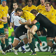 Adam Ashley Cooper, Australia, is tackled by All Blacks captain Richie McCaw during the New Zealand V Australia Semi Final match at the IRB Rugby World Cup tournament, Eden Park, Auckland, New Zealand, 16th October 2011. Photo Tim Clayton...