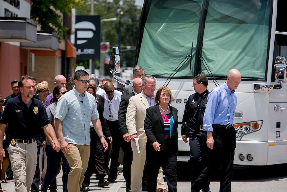 ORLANDO - JUNE 15, 2016: Orlando Mayor Buddy Dyer, Orange County Mayor Teresa Jacobs, Orlando Police Chief John Mina and Florida Governor Rick Scott head to a press conference outside the Pulse nightclub in Orlando, Florida. CREDIT: Sam Hodgson for The New York Times.