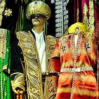Colorful Ottoman Sultan Kaftans at Kapaliçarşi Grand Bazaar in Istanbul, Turkey<br /> If you would like to dress like an Ottoman sultan, then go to the empire's former capital city of Constantinople (now called Istanbul, Turkey) and shop for these colorful kaftans at the Grand Bazaar (called Kapaliçarşi in Turkish) just like they did when this large, covered market first opened in the middle of the 15th century.  The kaftan (also spelled caftan) was a long, ornate coat or robe.  Its decorations indicted the person's rank and importance.  If you want to see the real kaftans, then visit the Topkapi Palace which is where the Ottoman Sultans lived from 1465 until 1856.  This museum displays a large collection of original artifacts.
