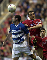 Copyright Sportsbeat. 0208 3926656<br />Picture: Henry Browne<br />Date: 18/04/2003<br />Reading v Nottingham Forest Nationwide First Division<br />Andy Hughes of Reading beats Riccardo Scimeca of Forest in the air