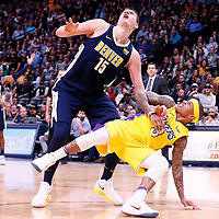 09 March 2018: Los Angeles Lakers guard Isaiah Thomas (3) vies for the rebound with Denver Nuggets center Nikola Jokic (15) during the Denver Nuggets125-116 victory over the Los Angeles Lakers, at the Pepsi Center, Denver, Colorado, USA.