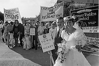Striking Eversure textile workers take time out from their wedding reception to call at the picket line where they have been out for a month . The strike was trying to get recognition of their Union the TGWU and reinstatement of sacked workers. Sheffield 15 July 1989