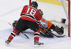 May 6, 2012; Newark, NJ, USA; New Jersey Devils right wing Steve Bernier (18) is stopped by Philadelphia Flyers goalie Ilya Bryzgalov (30) during the second period in game four of the 2012 Eastern Conference semifinals at the Prudential Center.