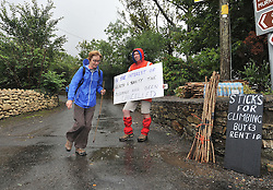 Padraig Boran from Finglas Order of Malta hold up a cancellation notice for pilgrims arriving at Croagh Patrick on reek sunday. <br /> Pic Conor McKeown