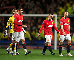 MANCHESTER, ENGLAND - Monday, April 30, 2012: Manchester United's players goalkeeper David de Gea, Chris Smalling, Wayne Rooney and Ryan Giggs look dejected after losing the Premiership match against Manchester City 1-0 at the City of Manchester Stadium. (Pic by David Rawcliffe/Propaganda)