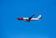LN-NGU Norwegian Air Shuttle, Boeing 737-800 on a blue sky background. Photographed in Spitsbergen, Svalbard, Norway