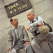 Akira Iwanaga (on left) and Tsutomu Yamaguchi (on right), pay their respects at the memorial marking the Nagasaki Atomic bombing blast on 9th August 1945, in Nagasaki, Japan,  Tuesday May 24th 2005. Both men were in Hiroshima on the day of the first atomic bombing, 6th Aug. 1945, and also in Nagasaki three days laeter on the day of the second atomic bombing of Japan by US Military.