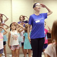 Claire Leeke, an instructor at TCT Camp, leads a group of girls in a song and dance routine during their time with her at the TCT Camp held at the Lyric.