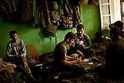 Afghan National Army soldiers play cards in their shared room at Combat Outpost Nolen.